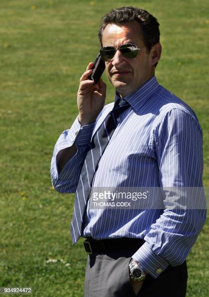 French rightwing presidential candidate Nicolas Sarkozy gives a phone call after visiting the Charles de Gaulle's memorial 16 April 2007 in Colombey...
