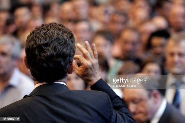 French rightwing presidential candidate of the ruling party Union for a Popular Movement Nicolas Sarkozy delivers a speech gesturing in front of...
