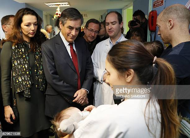 French rightwing Republicans party candidate for the 2017 presidential election Francois Fillon stands next to French MP Valerie Boyer as he speaks...