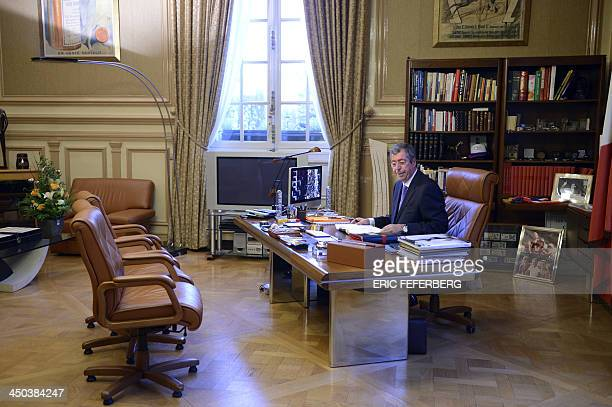 French rightwing UMP outgoing mayor of LevalloisPerret and candidate for his own succession for the 2014 municipal elections Patrick Balkany poses at...