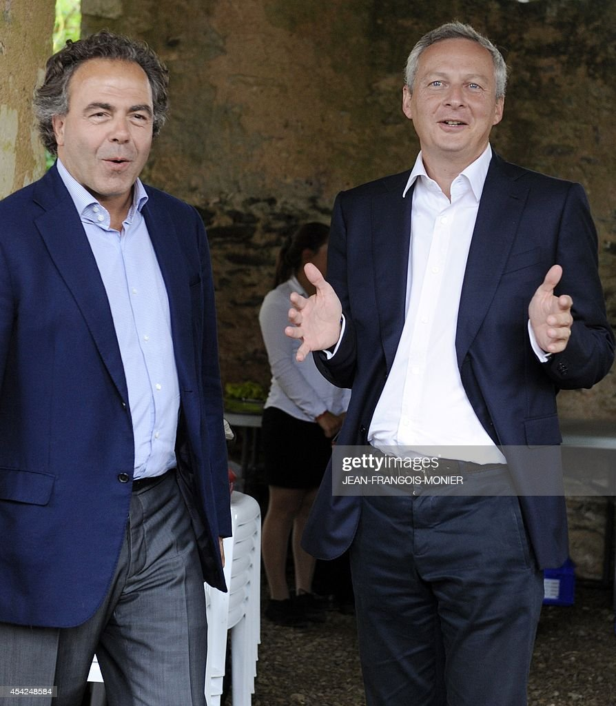 French right-wing UMP party interim General Secretary Luc Chatel (L) and UMP party MP Bruno Le Maire, who his running for the presidency of the UMP, talk after a meeting with militants on August 27, 2014 in Rouez-en-Champagne, western France.