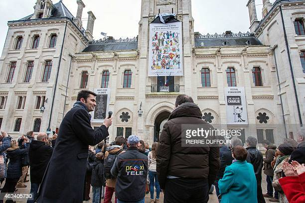 French rightwing UMP party Mayor of Angouleme Xavier Bonnefont looks on as a banner is unveiled on the facade of the Hotel de Ville of Angouleme...