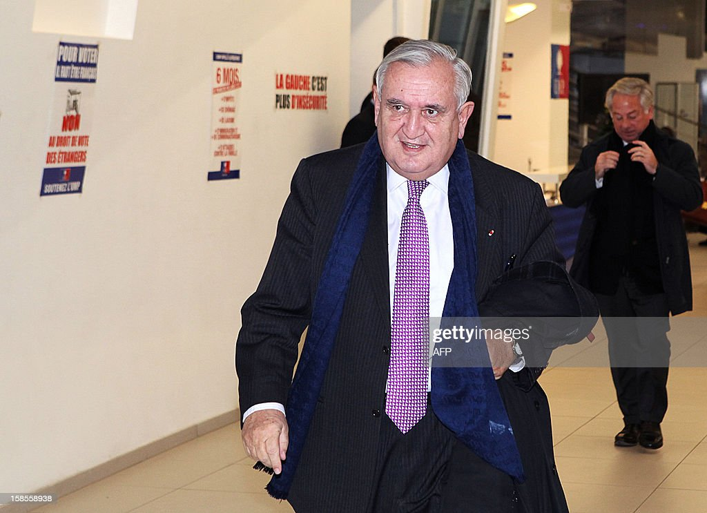 French right-wing UMP party Senator Jean-Pierre Raffarin leaves the party's headquarters after attending a political committee meeting on December 19, 2012 in Paris. The meeting came two days after rivals in a bitter leadership row that split France's former ruling party agreed to a new internal election after a contested first vote last month.