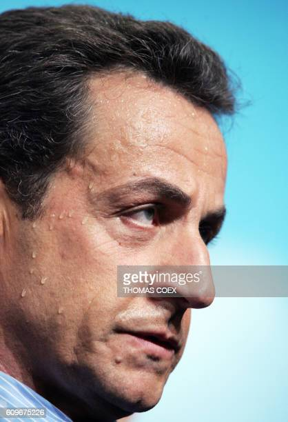 French right-wing UMP presidential candidate Nicolas Sarkozy sweats at the end of a campaign meeting 18 April 2007 in Issy-les-Moulineaux . French...