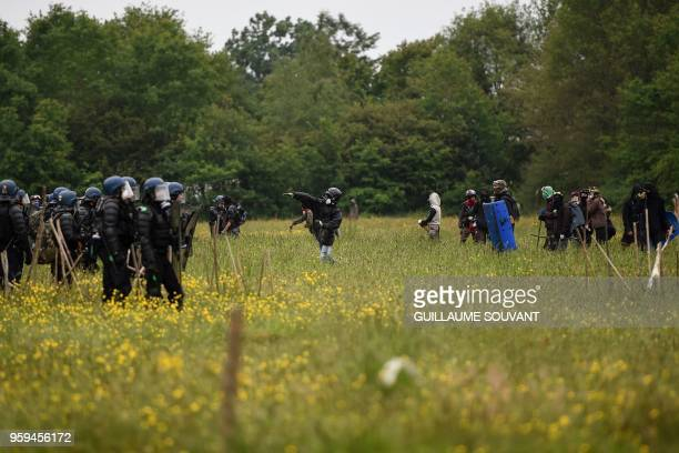 TOPSHOT French riot gendarmes clash with protesters during a second eviction of environmental protesters from the area known as ZAD at the site of an...