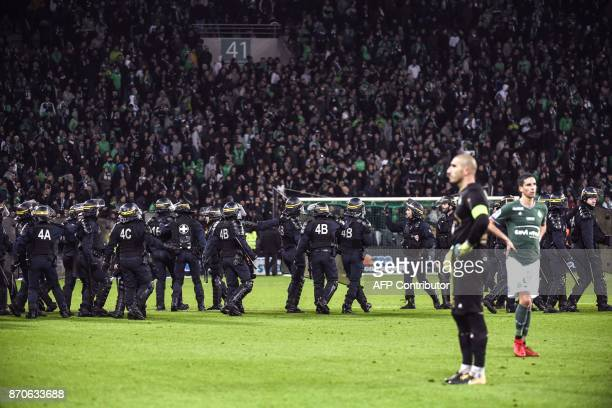 TOPSHOT French riot police are seen on the pitch where SaintEtienne fans descended during the French L1 football match between AS SaintEtienne and...