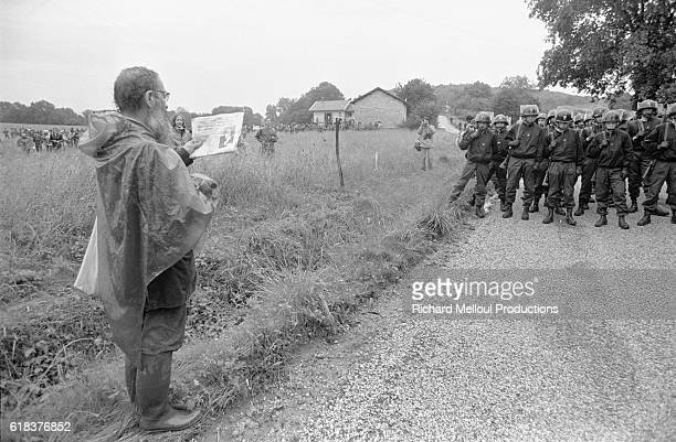 French riot police block the road against the 60000 European antinuclear activists protesting the breeder reactor at CreysMalville During the protest...