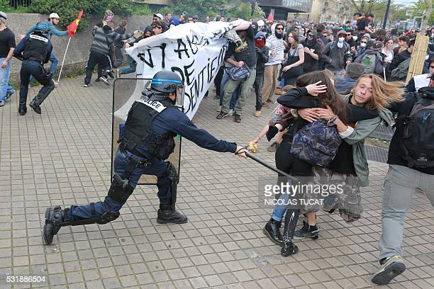 TOPSHOT French riot police clash with demontrators during a demonstration after the French government used the constitution's Article 493 to bypass...