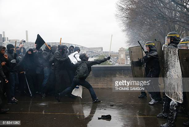TOPSHOT French riot police confront protesters during a demonstration against labour law reforms in the French capital Paris on March 31 2016 France...