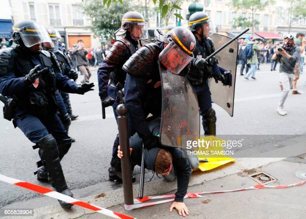TOPSHOT French riot police detain an injured man during a demonstration against the controversial labour reforms of the French government in Paris on...