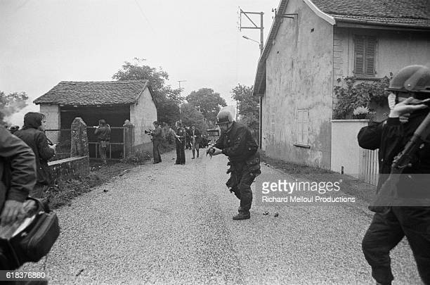 French riot police face off against the 60000 European antinuclear activists protest against the breeder reactor at CreysMalville During the protest...