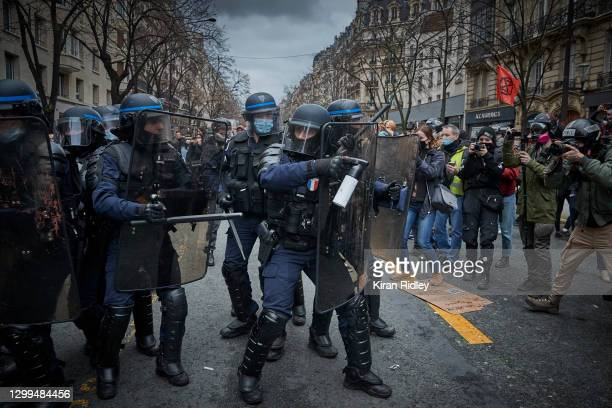 French Riot Police face protestors as demonstrations against the French Government's Global Security Bill turn violent on January 30, 2021 in Paris,...