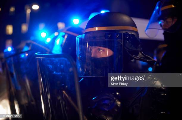 French Riot Police face protestors outside the National Assembly as protests against the French Government's proposed global security law bill turn...