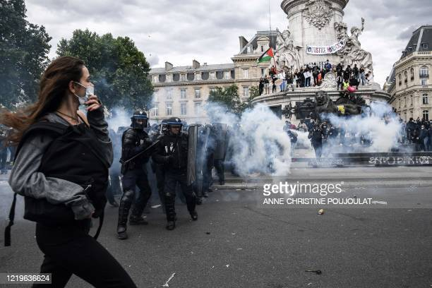 French riot police forces clash with protesters during a rally as part of the 'Black Lives Matter' worldwide protests against racism and police...