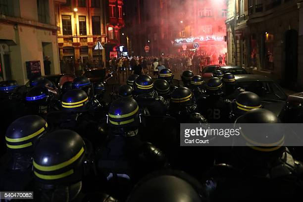French riot police march towards drunken English football fans as they clash on June 15 2016 in Lille France Police used tear gas and pepper spray on...