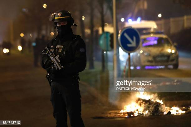 A French riot police officer secures the area during a protest in Bobigny a district of northeast Paris to denounce police brutality after a black...