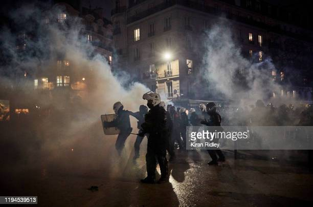 French Riot Police retreat through clouds of tear gas at Place de la Nation as thousands take to the streets of Paris in support of the National...