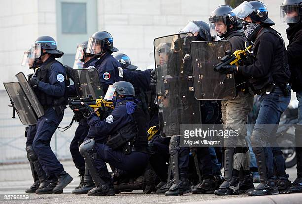 French riot police stand guard against protestors during the NATO summit on April 4 2009 in Strasbourg France The summit of the 28 NATO member...