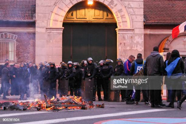 French riot police stand guard outside the entrance of the Fresnes prison near Paris on January 15 during a demonstration by prison guards after...