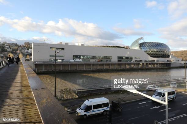French riot police vans are parked outside La Seine Musicale venue on l'ile Seguin in BoulogneBillancourt west of Paris on December 12 2017 during...