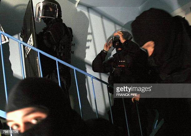 French riot policemen storm a buiding on February 18 during a major predawn operation in and around VilliersleBel a northern Paris suburb targeting...