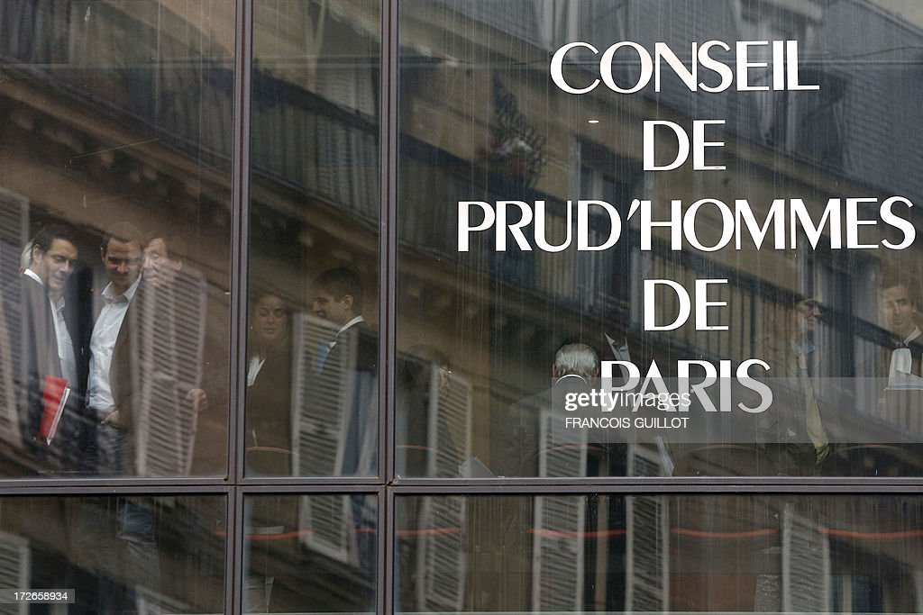 French rogue trader Jerome Kerviel (2ndL) and his lawyer David Koubbi (R) reflect in the window upon their arrival on July 4, 2013 in Paris, at the Prudhommes court (judicial system of relations between workers and employees). Kerviel lost last year his appeal against a three-year jail term and a 4.9-billion-euro fine for his part in France's biggest rogue-trading scandal. The 35-year-old was convicted of forgery and breach of trust for gambling away nearly five billion euros ($6.3-billion) in risky deals as a star trader at Societe Generale, one of Europe's biggest banks.