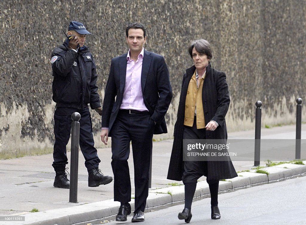 French rogue trader Jerome Kerviel (L) leaves 'La Sante' prison with his lawyer Elisabeth Meyer, on March 18 2008 in Paris, as a Paris court ordered today his release while investigators probe his role in a multi-billion-euro scandal at Societe Generale, the prosecutor's office said. Societe Generale blames the junior trader for losses of 4.9 billion euros (7.1 billion dollars) incurred after the bank was forced to unwind more than 50 billion euros of unauthorised deals he made.