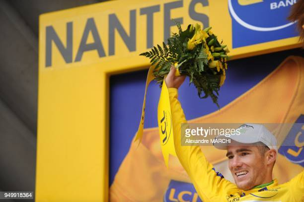 French Romain Feillu jubilates on the podium after winning the leader's yellow jersey on July 7 2008 in Nantes at the end of the 208 km third stage...