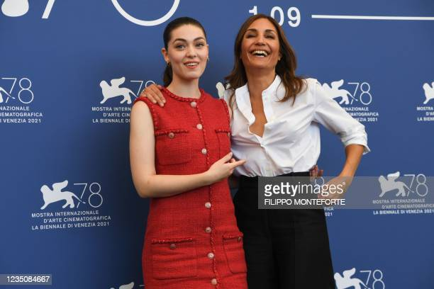 """French Romanian actress Anamaria Vartolomei and French director Audrey Diwan attend a photocall for the film """"l'Evenement"""" presented in competition..."""