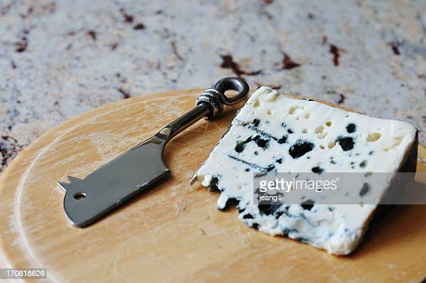 french roquefort blue cheese with mouse shaped knife - roquefort cheese stock photos and pictures