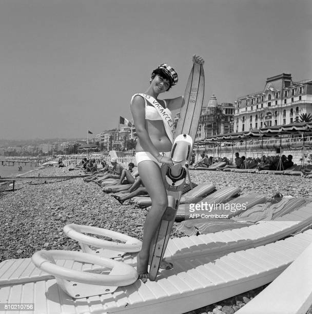 French RoseLys Martel smiles holding a waterski 07 July 1965 at a Nice's beach next to Negresco Palace after being elected the Queen of Holidays 1965...