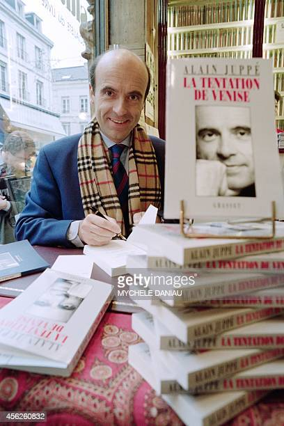 French RPR general secretary Alain Juppe signs his book 'La tentation de Venise' on February 4 in the bookshop Guillaume in Caen