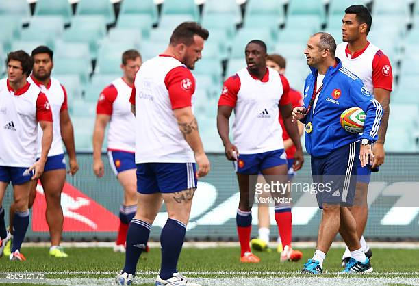 French rugby coach Philippe SaintAndre watches over his team during the France Captain's Run at Allianz Stadium on June 20 2014 in Sydney Australia