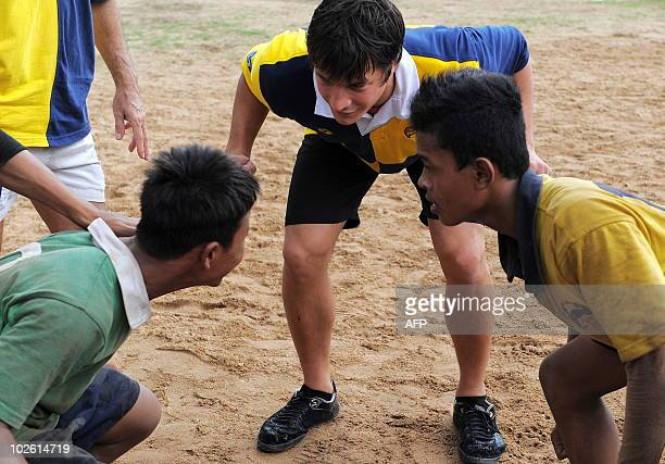French rugby international Francois Trinh Duc trains a Cambodian rugby team during his visits at the French NGO Puor un Sourire d'Enfant in Phnom...