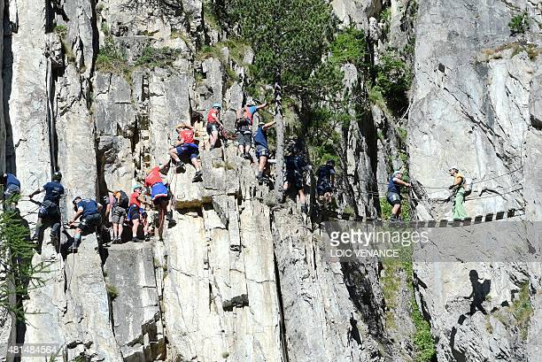 French rugby national team players and staff members rock climb during a Rugby Union World Cup 2015 training camp on July 21 2015 in Tignes...