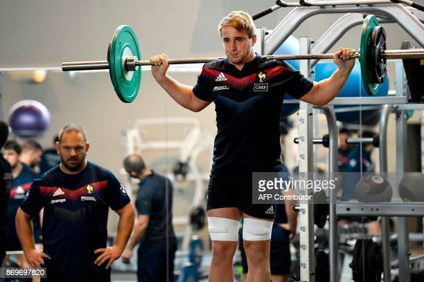 French rugby player Anthony Jelonch lifts weights next to South African naturalized French rugby player Daniel Kotze during a training session in...