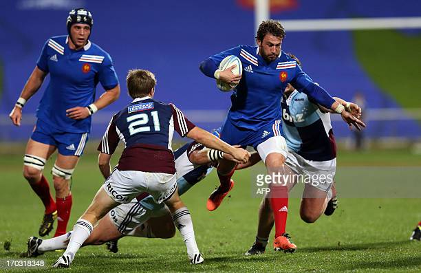 French rugby player Maxime Medard looks to beat the Blues defence during the rugby union match between the Auckland Blues and France at North Harbour...