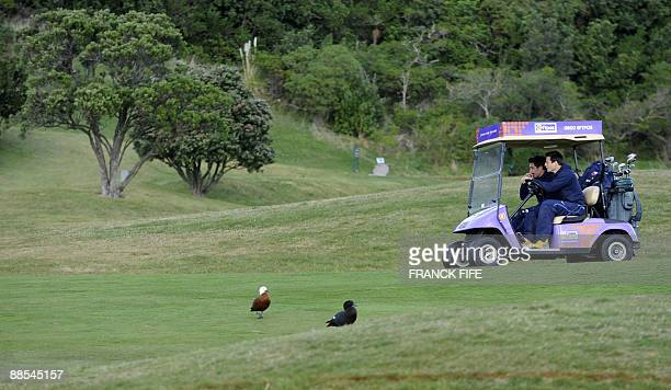 French rugby players Florian Fritz and Francois TrinhDuc play golf at the Miramar Golf Course in Wellington on June 18 2009 France on June 17 made...