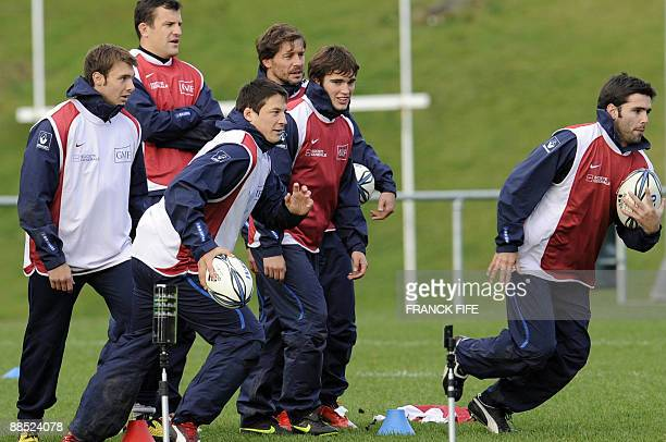 French rugby players Vincent Clerc Damien Traille Francois TrinhDuc Cedric Heymans Alexis Palission and Dimitri Yachvili train during a training...