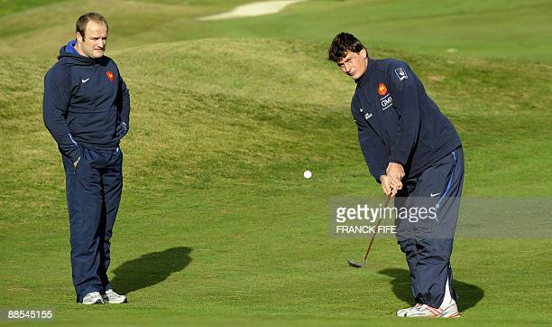 French rugby players Wiilliam Servat and Yanncik Jauzion play golf at the Miramar Golf Course in Wellington on June 18 2009 France on June 17 made...