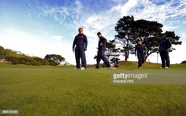 French rugby players Willaim Servat Yannick Jauzion Francois TrinhDuc and Thierry Dusautour play golf at the Miramar Golf Course in Wellington on...