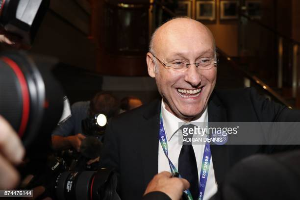 French rugby president Bernard Laporte celebrates after France is named to host the 2023 Rugby World Cup in London on November 15 2017 / AFP PHOTO /...