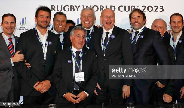 French rugby President Bernard Laporte poses with members of the bid team after France was named to host the 2023 Rugby World Cup in London on...