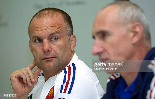 French rugby union coach Philippe SaintAndré speaks to the media as assistant coach Yannic Bru listens at a team press conference ahead of the third...