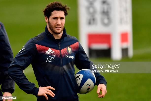 French rugby union national team scrumhalf Maxime Machenaud attends a training session two days ahead of a Six Nations match against Ireland on...