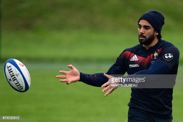 French rugby union national team wing Yoann Huget passes the ball during a captain's run session in Marcoussis near Paris on November 17 on the eve...