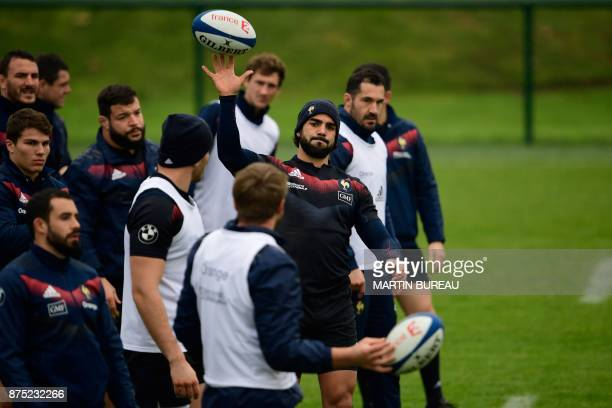 French rugby union national team wing Yoann Huget warms up during a captain's run session in Marcoussis near Paris on November 17 on the eve of the...