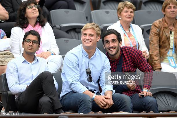 French rugby union player Jules Plisson attends the women's second round match between Hungary's Timea Babos and France's Kristina Mladenovic at the...