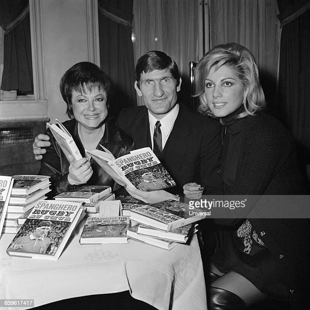 French Rugby Union player Walter Spanghero with singer Regine and swimmer Kiki Caron at a book signing for his book Rugby au Coeur