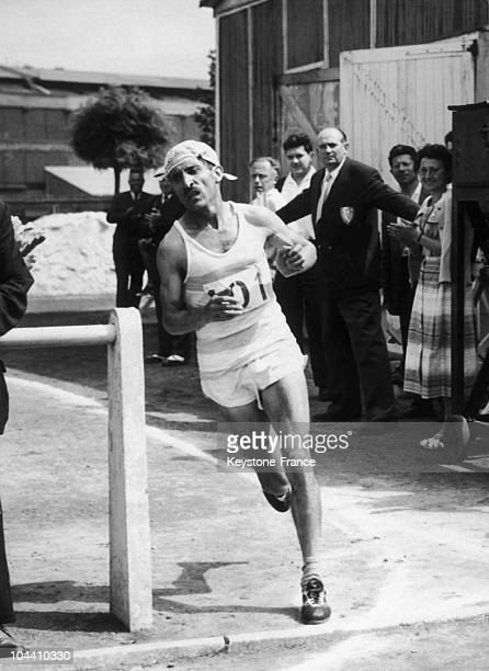 French runner Alain MIMOUN during the National Championship Marathon of France at the Kleber Colombe Stadium in Paris on July 201958 He took first...